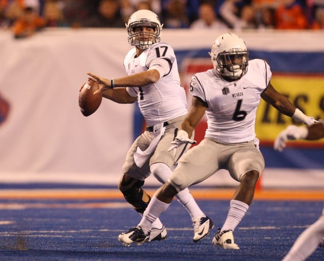 Oct 19, 2013; Boise, ID, USA; Nevada Wolf Pack quarterback Cody Fajardo (17) throws the ball during the third quarter against the Boise State Broncos at Bronco Stadium. The Broncos won 34-17. Mandatory Credit: Brian Losness-USA TODAY Sports