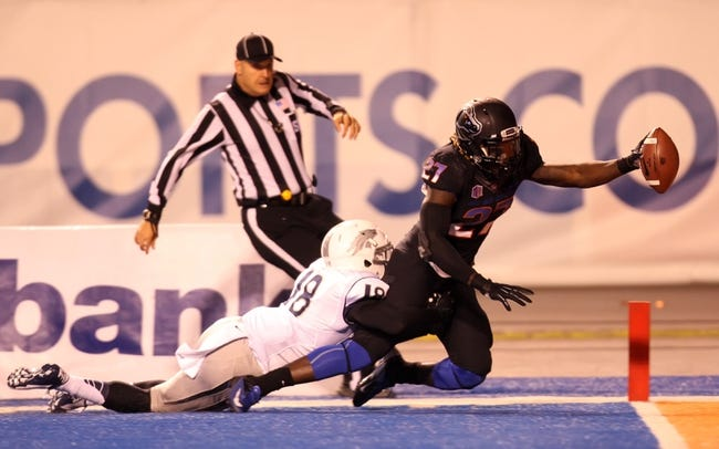 Oct 19, 2013; Boise, ID, USA; Boise State Broncos running back Jay Ajayi (27) scores a touchdown during the second half against the Nevada Wolf Pack at Bronco Stadium. The Broncos won 34-17. Mandatory Credit: Brian Losness-USA TODAY Sports