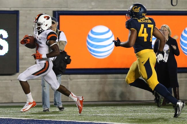 Oct 19, 2013; Berkeley, CA, USA; Oregon State Beavers wide receiver Brandin Cooks (7) scores a touchdown against the California Golden Bears during the second quarter at Memorial Stadium. Mandatory Credit: Kelley L Cox-USA TODAY Sports