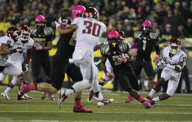 Oct 19, 2013; Eugene, OR, USA; Oregon Ducks running back Byron Marshall (9) runs the ball in the third quarter against the Washington State Cougars at Autzen Stadium. Mandatory Credit: Scott Olmos-USA TODAY Sports