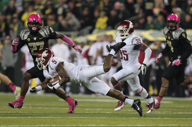 Oct 19, 2013; Eugene, OR, USA; Washington State Cougars wide receiver Rickey Galvin (5) returns a kick against the Oregon Ducks at Autzen Stadium. Mandatory Credit: Scott Olmos-USA TODAY Sports
