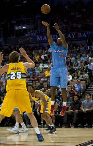 Oct 19, 2013; Las Vegas, NV, USA; Los Angeles Clippers guard Willie Green (34) takes a jump shot against the Denver Nuggets during an NBA preseason game  at Mandalay Bay Events Center.  The Clippers won the game in overtime 118-111. Mandatory Credit: Stephen R. Sylvanie-USA TODAY Sports