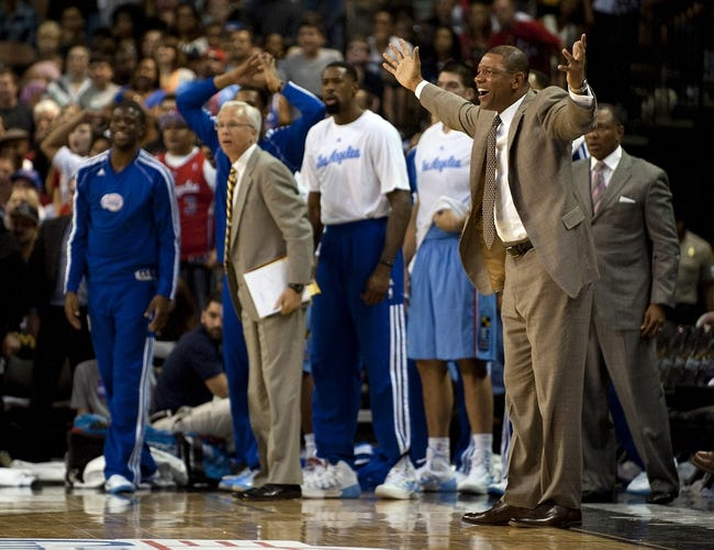 Oct 19, 2013; Las Vegas, NV, USA; Los Angeles Clippers head coach Doc Rivers reacts during an NBA preseason game against the Denver Nuggets at Mandalay Bay Events Center. The Clippers won the game in overtime 118-111. Mandatory Credit: Stephen R. Sylvanie-USA TODAY Sports