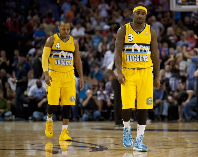 Oct 19, 2013; Las Vegas, NV, USA; Denver Nuggets guards Ty Lawson (3) and Randy Foye (4) walk back to the bench after failing to break a tie against the Los Angeles Clippers at the end of regulation time of an NBA preseason game at Mandalay Bay Events Center. The Clippers won the game in overtime 118-111. Mandatory Credit: Stephen R. Sylvanie-USA TODAY Sports