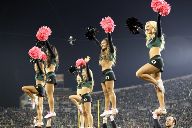 Oct 19, 2013; Eugene, OR, USA; Oregon Ducks cheerleaders entertain the fans against the Washington State Cougars at Autzen Stadium. Mandatory Credit: Scott Olmos-USA TODAY Sports