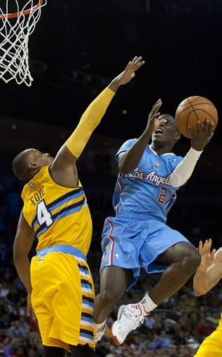 Oct 19, 2013; Las Vegas, NV, USA; Los Angeles Clippers guard Darren Collison (2) shoots against the defense of Denver Nuggets guard Randy Foye (4) during an NBA preseason game at Mandalay Bay Events Center. The Clippers won the game in overtime 118-111. Mandatory Credit: Stephen R. Sylvanie-USA TODAY Sports