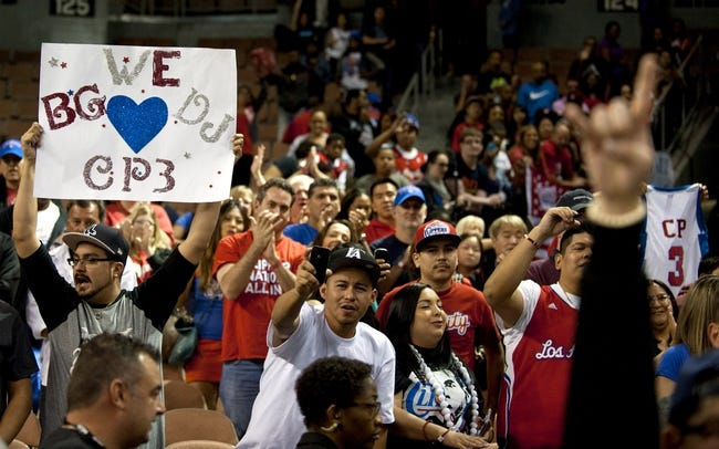 Oct 19, 2013; Las Vegas, NV, USA; Fans of Los Angeles Clippers guard Chris Paul hold up signs after a NBA preseason game against the Denver Nuggets at Mandalay Bay Events Center. The Clippers won the game in overtime 118-111. Mandatory Credit: Stephen R. Sylvanie-USA TODAY Sports