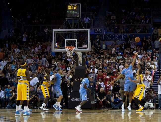 Oct 19, 2013; Las Vegas, NV, USA; Los Angeles Clippers center Ryan Hollins (15) defends a shot by the Denver Nuggets as regulation time expires at Mandalay Bay Events Center. The Clippers won the game in overtime 118-111. Mandatory Credit: Stephen R. Sylvanie-USA TODAY Sports