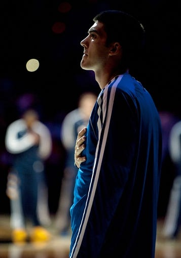 Oct 19, 2013; Las Vegas, NV, USA; Los Angeles Clippers center Byron Mullens stands during the singing of the national anthem before an NBA preseason game against the Denver Nuggets at Mandalay Bay Events Center. The Clippers won the game in overtime 118-111. Mandatory Credit: Stephen R. Sylvanie-USA TODAY Sports