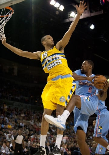Oct 19, 2013; Las Vegas, NV, USA; Los Angeles Clippers center DeAndre Jordan (6) is defended by Denver Nuggets forward Anthony Randolph (15) during an NBA preseason game at Mandalay Bay Events Center. The Clippers won the game in overtime 118-111. Mandatory Credit: Stephen R. Sylvanie-USA TODAY Sports