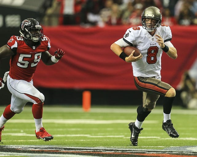 Oct 20, 2013; Atlanta, GA, USA; Tampa Bay Buccaneers quarterback Mike Glennon (8) runs the ball in the second half against the Atlanta Falcons at the Georgia Dome. The Falcons won 31-23. Mandatory Credit: Daniel Shirey-USA TODAY Sports