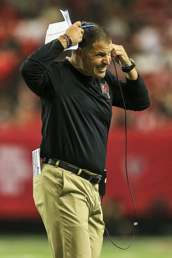 Oct 20, 2013; Atlanta, GA, USA; Tampa Bay Buccaneers head coach Greg Schiano reacts to a play in the second half against the Atlanta Falcons at the Georgia Dome. The Falcons won 31-23. Mandatory Credit: Daniel Shirey-USA TODAY Sports