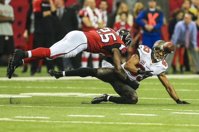 Oct 20, 2013; Atlanta, GA, USA; Atlanta Falcons safety William Moore (25) forces an incompletion by hitting Tampa Bay Buccaneers wide receiver Vincent Jackson (83) as he attempts to make a catch in the second half at the Georgia Dome. The Falcons won 31-23. Mandatory Credit: Daniel Shirey-USA TODAY Sports