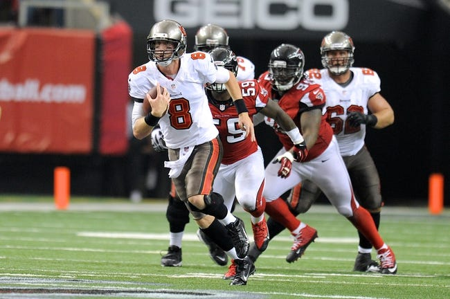 Oct 20, 2013; Atlanta, GA, USA; Tampa Bay Buccaneers runs for a first down against the Atlanta Falcons during the second half at the Georgia Dome. The Falcons defeated the Buccaneers 31-23.  Mandatory Credit: Dale Zanine-USA TODAY Sports
