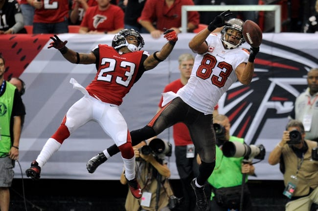 Oct 20, 2013; Atlanta, GA, USA; Tampa Bay Buccaneers wide receiver Vincent Jackson (83) can't hold on to a pass in the end zone behind Atlanta Falcons cornerback Robert Alford (23) during the second half at the Georgia Dome. The Falcons defeated the Buccaneers 31-23.  Mandatory Credit: Dale Zanine-USA TODAY Sports