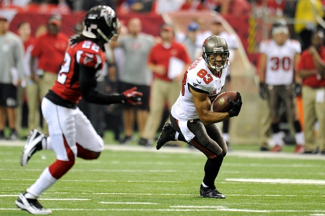 Oct 20, 2013; Atlanta, GA, USA; Tampa Bay Buccaneers wide receiver Vincent Jackson (83) runs after a catch in front of Atlanta Falcons cornerback Asante Samuel (22) during the second half at the Georgia Dome. The Falcons defeated the Buccaneers 31-23.  Mandatory Credit: Dale Zanine-USA TODAY Sports