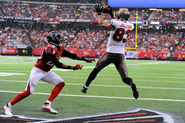 Oct 20, 2013; Atlanta, GA, USA; Tampa Bay Buccaneers wide receiver Vincent Jackson (83) catches a touchdown pass in front of Atlanta Falcons free safety Thomas DeCoud (28) during the second half at the Georgia Dome. The Falcons defeated the Buccaneers 31-23.  Mandatory Credit: Dale Zanine-USA TODAY Sports