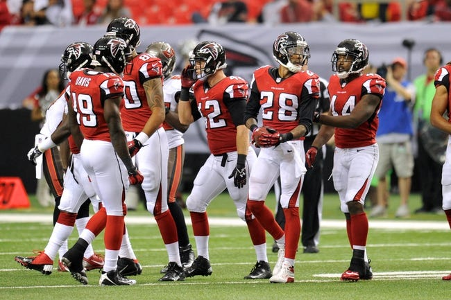 Oct 20, 2013; Atlanta, GA, USA; Atlanta Falcons free safety Thomas DeCoud (28) reacts with team mates after recovering an on sides kick against the Tampa Bay Buccaneers during the second half at the Georgia Dome. The Falcons defeated the Buccaneers 31-23.  Mandatory Credit: Dale Zanine-USA TODAY Sports