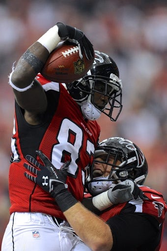 Oct 20, 2013; Atlanta, GA, USA; Atlanta Falcons wide receiver Harry Douglas (83) reacts with fullback Patrick DiMarco (42) after catching a touchdown pass against the Tampa Bay Buccaneers during the first half at the Georgia Dome. The Falcons defeated the Buccaneers 31-23.  Mandatory Credit: Dale Zanine-USA TODAY Sports