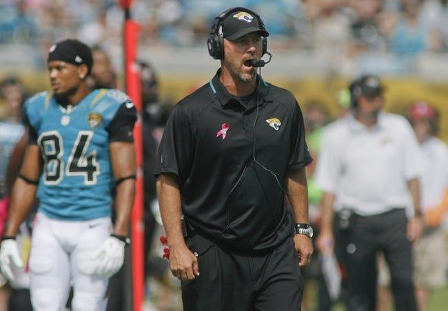 Oct 20, 2013; Jacksonville, FL, USA; Jacksonville Jaguars head coach Gus Bradley reacts in the second quarter of their game against the San Diego Chargers at EverBank Field. The San Diego Chargers defeated the Jacksonville Jaguars 24-6. Mandatory Credit: Phil Sears-USA TODAY Sports