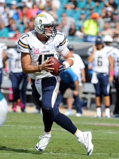 Oct 20, 2013; Jacksonville, FL, USA; San Diego Chargers quarterback Philip Rivers (17) looks to pass the ball during the game against the Jacksonville Jaguars at EverBank Field. Mandatory Credit: Melina Vastola-USA TODAY Sports