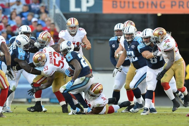 Oct 20, 2013; Nashville, TN, USA; Tennessee Titans running back Chris Johnson (28) is tackled by San Francisco 49ers defensive tackle Ray McDonald (91) during the second half at LP Field. The 49ers beat the Titans 31-17. Mandatory Credit: Don McPeak-USA TODAY Sports