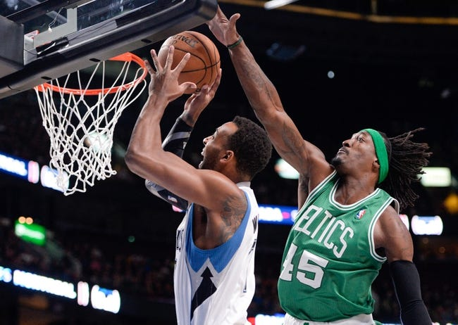 Oct 20, 2013; Montreal, Quebec, CAN; Minnesota Timberwolves forward Derrick Williams (7) goes to the net and Boston Celtics forward Gerald Wallace (45) defends during the first quarter at the Bell Centre. Mandatory Credit: Eric Bolte-USA TODAY Sports