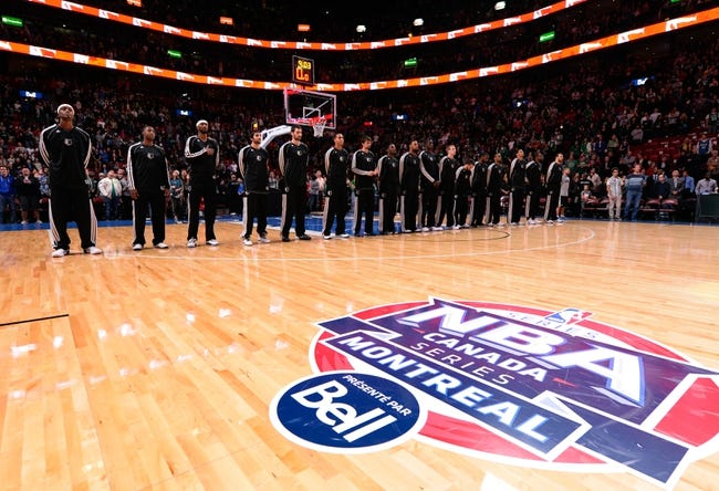 Oct 20, 2013; Montreal, Quebec, CAN; Minnesota Timberwolves during the playing of the national anthems before their game against the Boston Celtics at the Bell Centre. Mandatory Credit: Eric Bolte-USA TODAY Sports