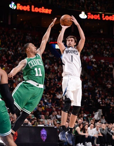 Oct 20, 2013; Montreal, Quebec, CAN; Minnesota Timberwolves guard Alexey Shved (1) shoots over Boston Celtics guard Courtney Lee (11) during the first quarter at the Bell Centre. Mandatory Credit: Eric Bolte-USA TODAY Sports