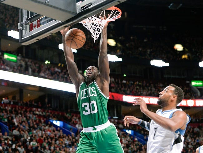 Oct 20, 2013; Montreal, Quebec, CAN; Boston Celtics forward Brandon Bass (30) dunks over Minnesota Timberwolves forward Derrick Williams (7) during the third quarter at the Bell Centre. Mandatory Credit: Eric Bolte-USA TODAY Sports
