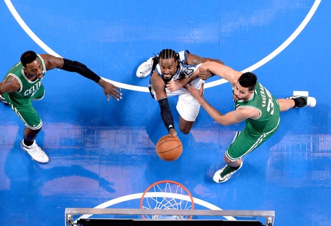 Oct 20, 2013; Montreal, Quebec, CAN; Minnesota Timberwolves center Ronny Turiaf (32) battles for a rebound with Boston Celtics forward Jeff Green (8) and teammate Vitor Faverani (38) during the third quarter at the Bell Centre. Mandatory Credit: Eric Bolte-USA TODAY Sports