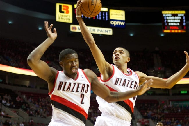 Oct 20, 2013; Portland, OR, USA; Portland Trail Blazers small forward Nicolas Batum (88) grabs a rebound over teammate shooting guard Wesley Matthews (2) in the first half against the Sacramento Kings at Moda Center. Mandatory Credit: Jaime Valdez-USA TODAY Sports