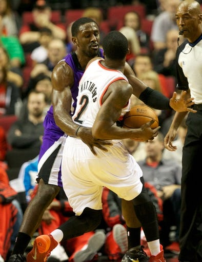 Oct 20, 2013; Portland, OR, USA; Sacramento Kings power forward Patrick Patterson (9) defends Portland Trail Blazers shooting guard Wesley Matthews (2) in the first half at Moda Center. Mandatory Credit: Jaime Valdez-USA TODAY Sports