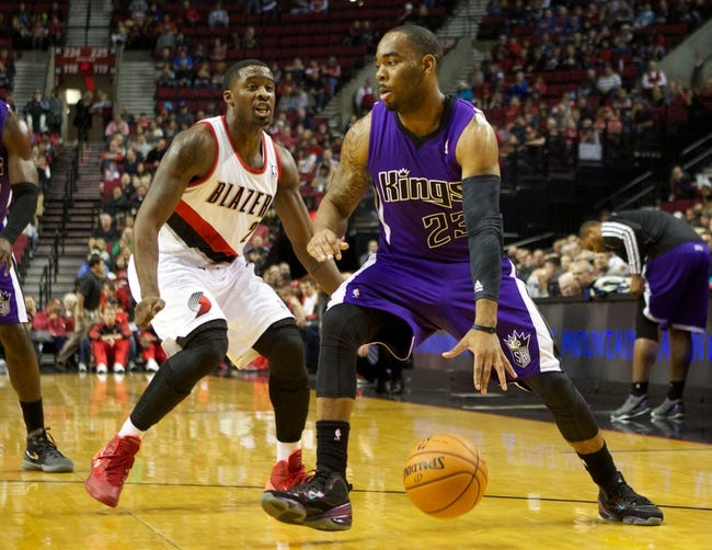 Oct 20, 2013; Portland, OR, USA; Sacramento Kings shooting guard Marcus Thornton (23) dribbles past Portland Trail Blazers shooting guard Wesley Matthews (2) in the first half at Moda Center. Mandatory Credit: Jaime Valdez-USA TODAY Sports
