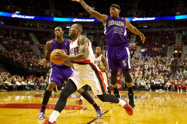 Oct 20, 2013; Portland, OR, USA; Portland Trail Blazers point guard Mo Williams (25) drives to the basket against Sacramento Kings point guard Isaiah Thomas (22) in the second half at Moda Center. Mandatory Credit: Jaime Valdez-USA TODAY Sports