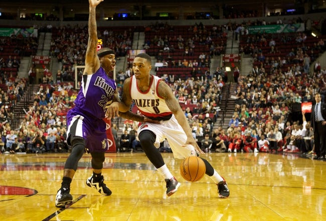 Oct 20, 2013; Portland, OR, USA; Sacramento Kings point guard Isaiah Thomas (22) defends Portland Trail Blazers point guard Damian Lillard (0) in the second half at Moda Center. Mandatory Credit: Jaime Valdez-USA TODAY Sports