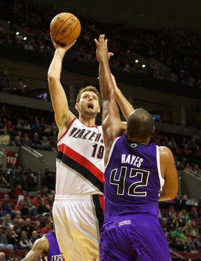 Oct 20, 2013; Portland, OR, USA; Portland Trail Blazers power forward Joel Freeland (19) shoots over Sacramento Kings power forward Chuck Hayes (42) in the second half at Moda Center. Mandatory Credit: Jaime Valdez-USA TODAY Sports