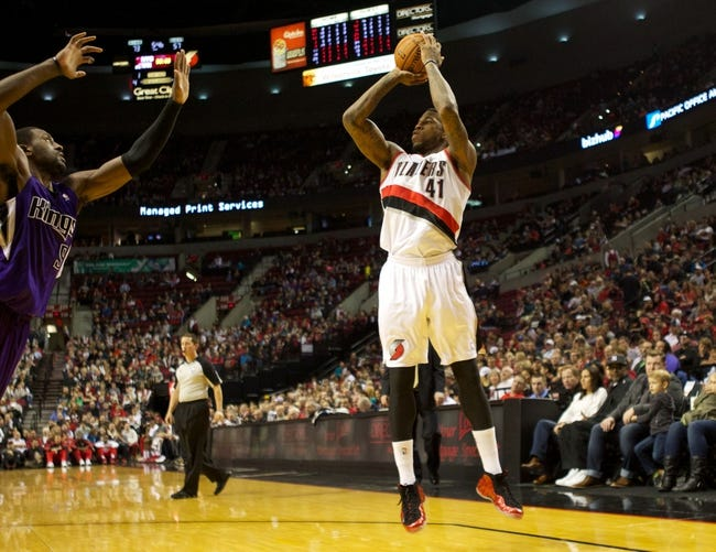 Oct 20, 2013; Portland, OR, USA; Portland Trail Blazers power forward Thomas Robinson (41) shoots over Sacramento Kings power forward Patrick Patterson (9) in the second half at Moda Center. Mandatory Credit: Jaime Valdez-USA TODAY Sports