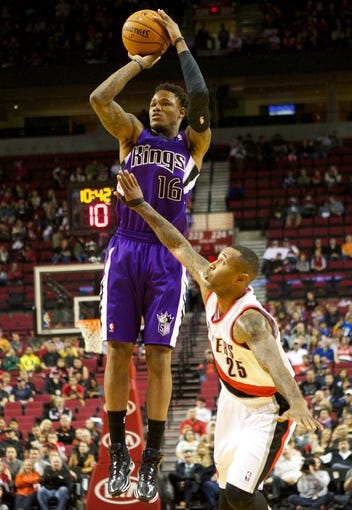 Oct 20, 2013; Portland, OR, USA; Sacramento Kings shooting guard Ben McLemore (16) shoots over Portland Trail Blazers point guard Mo Williams (25) in the second half at Moda Center. Mandatory Credit: Jaime Valdez-USA TODAY Sports