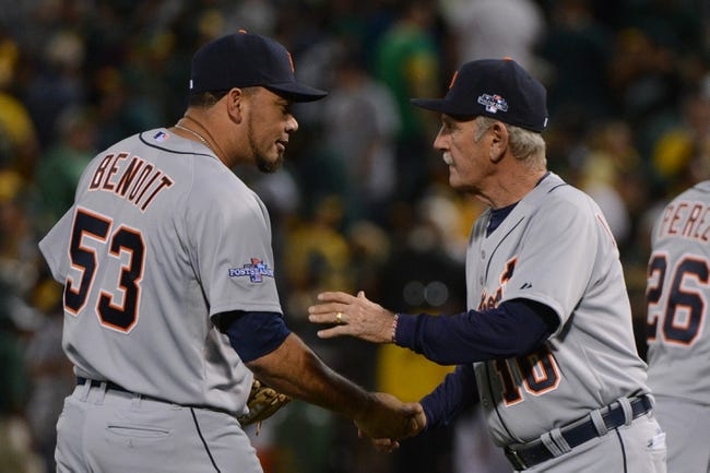 October 4, 2013; Oakland, CA, USA; Detroit Tigers relief pitcher Joaquin Benoit (53) celebrates with manager Jim Leyland (10, right) after game one of the American League divisional series playoff baseball game against the Oakland Athletics at O.co Coliseum. The Tigers defeated Athletics 3-2. Mandatory Credit: Kyle Terada-USA TODAY Sports