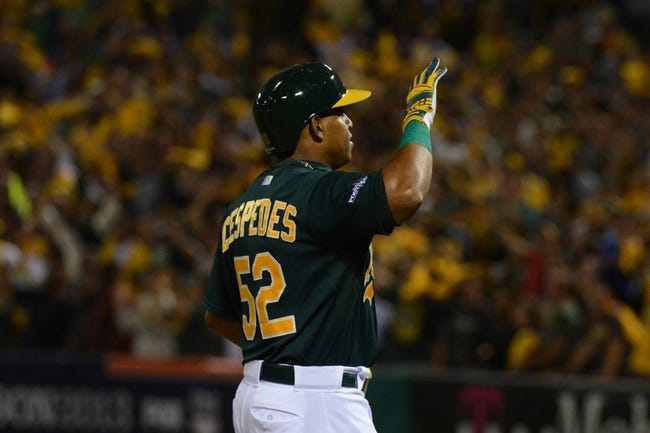 October 4, 2013; Oakland, CA, USA; Oakland Athletics left fielder Yoenis Cespedes (52) celebrates after hitting a home run during the seventh inning in game one of the American League divisional series playoff baseball game against the Detroit Tigers at O.co Coliseum. The Tigers defeated Athletics 3-2. Mandatory Credit: Kyle Terada-USA TODAY Sports