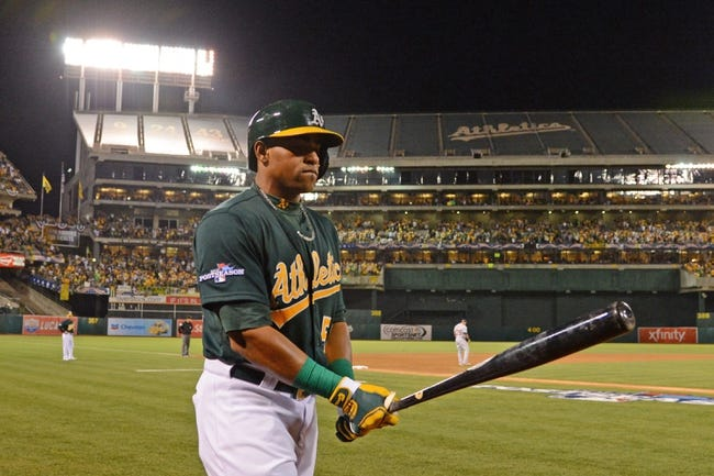 October 4, 2013; Oakland, CA, USA; Oakland Athletics left fielder Yoenis Cespedes (52) walks to the on-deck circle during the ninth inning in game one of the American League divisional series playoff baseball game against the Detroit Tigers at O.co Coliseum. The Tigers defeated Athletics 3-2. Mandatory Credit: Kyle Terada-USA TODAY Sports
