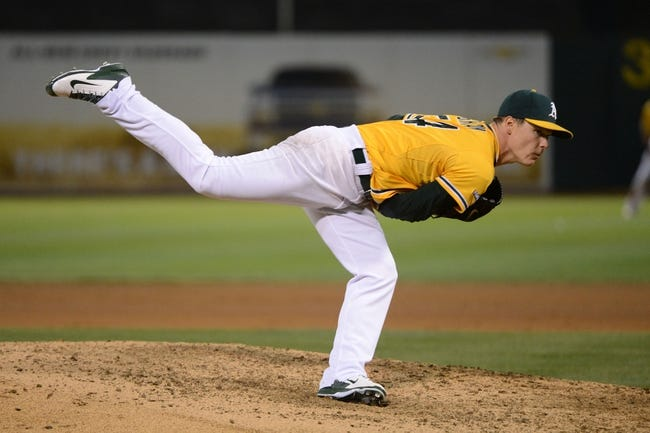 October 5, 2013; Oakland, CA, USA; Oakland Athletics starting pitcher Sonny Gray (54) delivers a pitch during the eighth inning in game two of the American League divisional series playoff baseball game against the Detroit Tigers at O.co Coliseum. The Oakland Athletics defeated the Detroit Tigers 1-0. Mandatory Credit: Kyle Terada-USA TODAY Sports