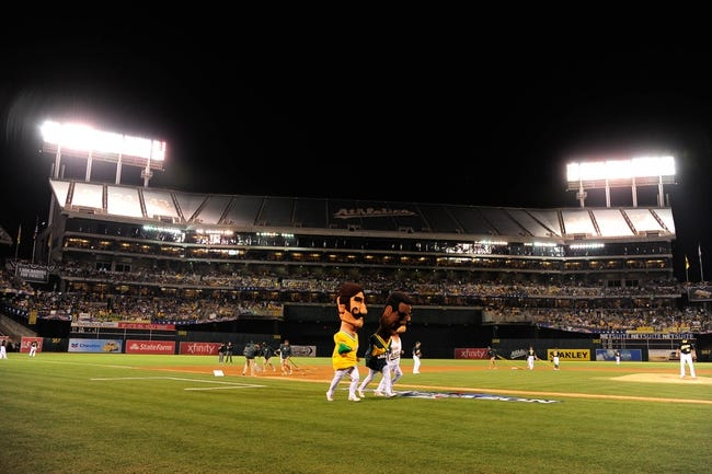 October 5, 2013; Oakland, CA, USA; Oakland Athletics mascots Rollie Fingers (left), Rickey Henderson (center), and Dennis Eckersley (right) run the field in a race after the sixth inning in game two of the American League divisional series playoff baseball game against the Detroit Tigers at O.co Coliseum. The Oakland Athletics defeated the Detroit Tigers 1-0. Mandatory Credit: Kyle Terada-USA TODAY Sports