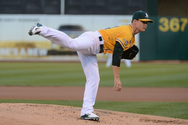 October 5, 2013; Oakland, CA, USA; Oakland Athletics starting pitcher Sonny Gray (54) delivers a pitch during the first inning in game two of the American League divisional series playoff baseball game against the Detroit Tigers at O.co Coliseum. The Oakland Athletics defeated the Detroit Tigers 1-0. Mandatory Credit: Kyle Terada-USA TODAY Sports