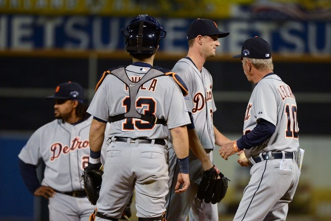 October 5, 2013; Oakland, CA, USA; Detroit Tigers relief pitcher Drew Smyly (33, second from right) hands the baseball to manager Jim Leyland (10) in a pitching change during the eighth inning in game two of the American League divisional series playoff baseball game against the Oakland Athletics at O.co Coliseum. The Oakland Athletics defeated the Detroit Tigers 1-0. Mandatory Credit: Kyle Terada-USA TODAY Sports