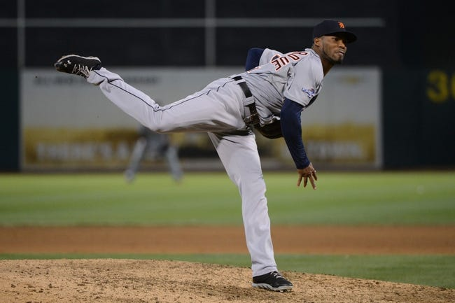 October 5, 2013; Oakland, CA, USA; Detroit Tigers relief pitcher Al Alburquerque (62) delivers a pitch during the eighth inning in game two of the American League divisional series playoff baseball game against the Oakland Athletics at O.co Coliseum. The Oakland Athletics defeated the Detroit Tigers 1-0. Mandatory Credit: Kyle Terada-USA TODAY Sports