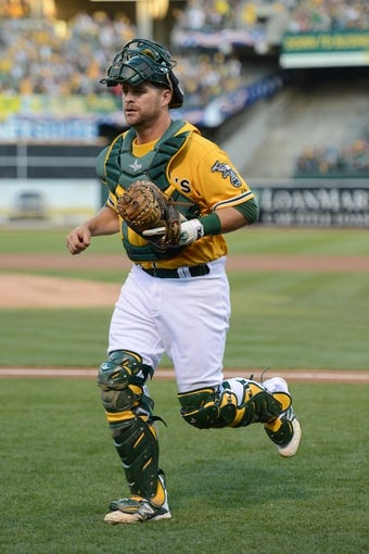 October 5, 2013; Oakland, CA, USA; Oakland Athletics catcher Stephen Vogt (21) jogs to the dugout after the first inning in game two of the American League divisional series playoff baseball game against the Detroit Tigers at O.co Coliseum. The Oakland Athletics defeated the Detroit Tigers 1-0. Mandatory Credit: Kyle Terada-USA TODAY Sports