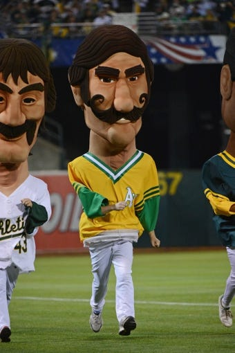 October 5, 2013; Oakland, CA, USA; Oakland Athletics mascot Rollie Fingers runs the field in a mascot race during the sixth inning in game two of the American League divisional series playoff baseball game against the Detroit Tigers at O.co Coliseum. The Oakland Athletics defeated the Detroit Tigers 1-0. Mandatory Credit: Kyle Terada-USA TODAY Sports
