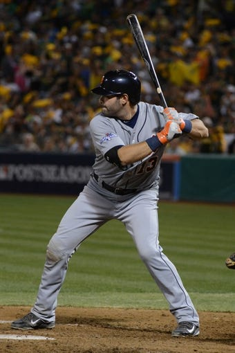 October 5, 2013; Oakland, CA, USA; Detroit Tigers catcher Alex Avila (13) bats during the seventh inning in game two of the American League divisional series playoff baseball game against the Oakland Athletics at O.co Coliseum. The Oakland Athletics defeated the Detroit Tigers 1-0. Mandatory Credit: Kyle Terada-USA TODAY Sports